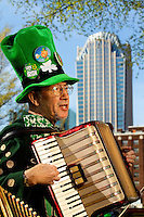 Photography of the Charlotte NC St. Patrick's Day Parade in March 2012. Image shows a member of the Carolina Accordion - Banjo Association performing in the parade.