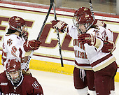 Jessica Martino (BC - 26), Kelli Stack (BC - 16) and Melissa Bizzari (BC - 4) celebrate Bizzari's goal. - The Boston College Eagles defeated the visiting Harvard University Crimson 6-2 on Sunday, December 5, 2010, at Conte Forum in Chestnut Hill, Massachusetts.