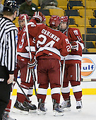 Ryan Grimshaw (Harvard - 6), Danny Biega (Harvard - 9), Luke Greiner (Harvard - 24), Colin Moore (Harvard - 12) - The Harvard University Crimson defeated the Boston University Terriers 5-4 in the 2011 Beanpot consolation game on Monday, February 14, 2011, at TD Garden in Boston, Massachusetts.