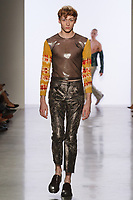 Model walks runway in an outfit by Alex Mangus, for the 2017 Pratt fashion show on May 4, 2017 at Spring Studios in New York City.
