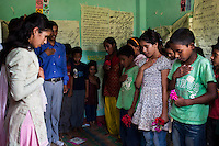 Members of the Kishuri Sachetana Child Club sing the Nepal national anthem before a meeting in their activity center in Thahuri Tole, Chhinchu, Surkhet district, Western Nepal, on 1st July 2012. These Child Clubs, supported by the government, Save the Children and their local partner NGO Safer Society, advocate for child rights and against child marriages and use peer support and education to end child marriages and raise awareness. Photo by Suzanne Lee for Save The Children UK