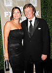 Nigel Lythgoe  and guest at the Fox 2009 Primetime Emmy Nominees party at Cicada in Los Angeles, September 29th 2009.