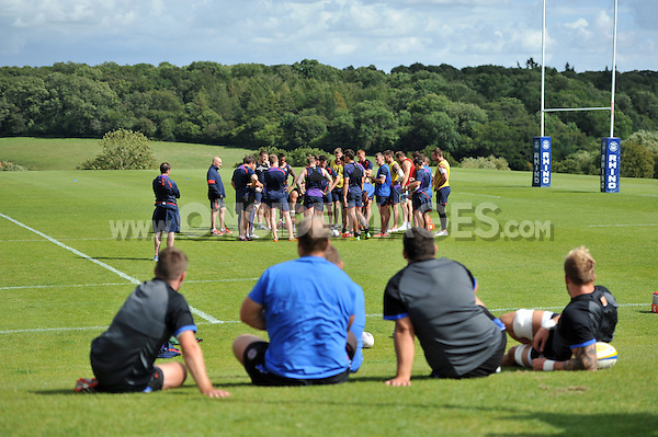 Bath coaches and players look on during visiting rugby league side Wigan Warriors' training. Bath Rugby pre-season training session on August 18, 2014 at Farleigh House in Bath, England. Photo by: Patrick Khachfe/Onside Images