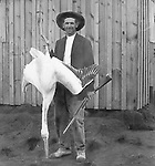 Jerome ID:  Hunter showing off his prize Pelican - 1910.  Brady Stewart and three friends went to Idaho on a lark from 1909 thru early 1912. As part of the Mondell Homestead Act, they received a land grant of 160 acres north of the Snake River.  For 2 ½  years, Brady Stewart photographed the adventures of farming along with the spectacular landscapes.