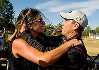 Sept. 6, 2010; Clermont, IN, USA; NHRA top fuel dragster driver Larry Dixon (right) celebrates with wife Allison Dixon after winning the U.S. Nationals at O'Reilly Raceway Park at Indianapolis. Mandatory Credit: Mark J. Rebilas-