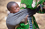 A baby rests on its mother's back in Toya, a village in northern Mali near Timbuktu. The region was seized by Islamist fighters in 2012 and then liberated by French and Malian soldiers in early 2013.