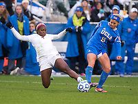 Rosie White (13) of UCLA fights for the ball with Jamia Fields (4) of Florida State during the NCAA Women's College Cup finals at WakeMed Soccer Park in Cary, NC.  UCLA defeated Florida State, 1-0, in overtime.