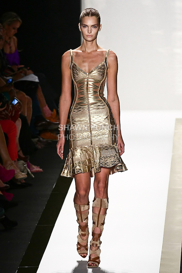 Gertrud Hegelund  walks the runway in a gold foil bandage peplum dress, with toffee gladiator boot, by Max Azria for the Herve Leger by Max Azria Spring 2012 fashion show, during Mercedes-Benz Fashion Week Spring 2012.