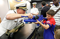 New York, USA. 22nd May, 2014. A boy checks a simulate riffle during the Fleet Week at pier 92 in Manhattan, New York.  Kena Betancur/VIEWpress
