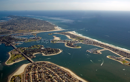 Aerial view of Mission Bay near San Diego, California, looking south. Mission Bay is a bay located south of the Pacific Beach community of San Diego, California. The bay is part of the recreational Mission Bay Park, which is the largest man-made aquatic park in the country, consisting of 4,235 acres, approximately 46% land and 54% water. The combined area makes Mission Bay Park the ninth largest municipally-owned park in the United States. Wakeboarding, jet skiing, sailing, and camping are popular on the bay (wiki 2009).