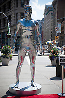 A larger-than-life 10 foot stature of soccer star David Beckham in his skivvies promoting his brand of underwear carried by H&M department stores is seen in the Flatiron neighborhood of New York on Thursday, August 16, 2012. The store has also featured mass-market fashion by designers Versace, Karl Lagerfeld, Stella McCartney among others.  (© Richard B. Levine)