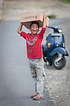 Kotomanbung, Western Sumatra, Indonesia, 8th October 2009: A boy receives a Hygeine Pack from international charity Save the Children after his house was determined unsafe to live in following the devastating earthquake in Western Sumatra that claimed the lives of an estimated 2000 people.?photo: Joseph Feil