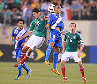 Guatemala Wilfred Velasquez (9) goes up to head the ball against Mexico Israel Castro (8)    Mexico defeated Guatemala 2-1 in the quaterfinals for the 2011 CONCACAF Gold Cup , at the New Meadowlands Stadium, Saturday June 18, 2011.