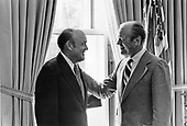 United States President Gerald R. Ford, right, with his old friend, Melvin Laird, left, in the Oval Office at the White House in Washington, D.C. on August 11, 1974.  Ford and Laird served together in the United States House of Representatives.  Laird was appointed as the nation's tenth Secretary of Defense by President Richard M. Nixon.  He served as Secretary from January 22, 1969 to January 29, 1973.  Nixon awarded Laird the Presidential Medal of Freedom on March 26, 1974.<br /> Mandatory Credit: David Hume Kennerly / White House via CNP