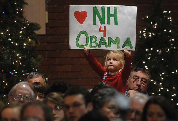 Manchester, New Hampshire: December 19, 2007.Lylah Asselin, 3, lifts up a sign with a message supporting presidential candidate Barack Obama during  a campaign town hall meeting featuring Obama (off camera). This event happened at the Raddison Hotel. On this date, Obama was competing in the New Hampshire presidential primary.  ©Christopher Fitzgerald / CandidatePhotos.com