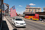 Downtown US 95 car, flag and Mizpah Hotel (abandoned)