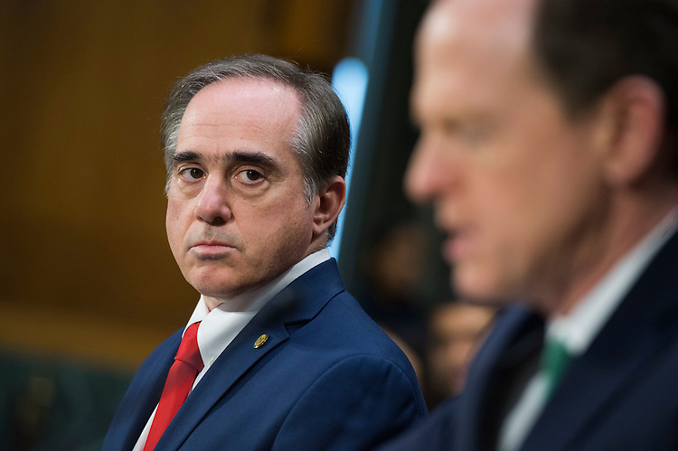 UNITED STATES - FEBRUARY 01: David Shulkin, left, nominee for Veterans Affairs secretary, listens to Sen. Pat Toomey, R-Pa., introduce him during his Senate Veterans' Affairs Committee confirmation hearing in Dirksen Building, February 1, 2017. (Photo By Tom Williams/CQ Roll Call)