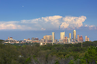 From a hiking trail on the edge of some of the Zilker Park trails, this Austin image shows downtown and the Austin skyline. To the north (far left) is the Texas State Capitol. Prominent buildings rise high such as the Austonian and the Frost Bank Tower, both Austin icons. This photograph of downtown Austin was captured on a very nice evening in October.