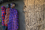 Young Maasai men waiting for the emorata, Losho Village, Kenya
