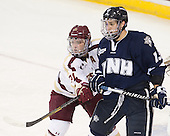Steven Whitney (BC - 21), Dan Correale (UNH - 13) - The Boston College Eagles and University of New Hampshire Wildcats tied 4-4 on Sunday, February 17, 2013, at Kelley Rink in Conte Forum in Chestnut Hill, Massachusetts.
