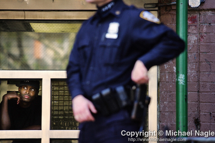 BROOKLYN - MAY 07, 2006: Police officers stand guard in front of 340 Williams Street, where a man allegedly shot four other people in their apartment, on May 6, 20006 in Brooklyn.  A young girl died and others ended up in critical condition.  (PHOTOGRAPH BY MICHAEL NAGLE)