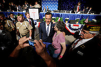 Candidate for president Mitt Romney mingles with attendees after his speech during the Veterans of Foreign Wars national convention, Tuesday, Aug. 30, 2011, in San Antonio. (Darren Abate/pressphotointl.com)