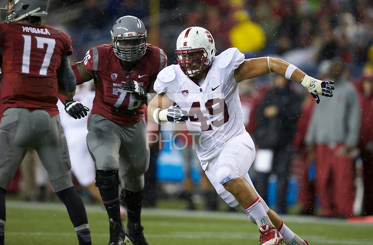 SEATTLE, WA - September 28, 2013: Stanford defensive end Ben Gardner rushes the quarterback during play against Washington State at CenturyLink Field. Stanford won 55-17.