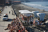 January 1st, 2009.  La Jolla Shores, CA, USA.  Hundreds of swimmers pose for a photograph before entering the water for the 32nd Annual La Jolla Swim Club's traditional New Years Day Polar Bear Swim near the Lifeguard Tower in La Jolla Shores.