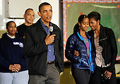 United States President Barack Obama (L) makes remarks as first lady Michelle Obama (R) and daughter Malia embrace as they join volunteers to participate in a service project, at Browne Education Center, in Washington, DC, USA, on the Martin Luther King Jr national holiday, 16 January 2012. The project was in memory of the legacy of community service, promoted by the late civil rights leader, who was assassinated in 1968. .Credit: Mike Theiler / Pool via CNP