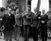 Paris, France - August 26, 1944 -- General Charles De Gaulle, center, stands in front of the Arc De Triomph, in Paris, France on August 26, 1944, watching a victory parade which is in celebration of the city's liberation from its four years of German rule..Credit: U.S. Army via CNP