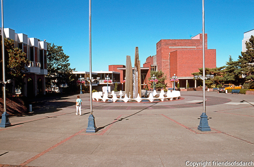 Victoria: Centennial Square, adjoining City Hall--Douglas St.. In the background, the former Pantages Theatre, now the McPherson Playhouse.  Photo '88.