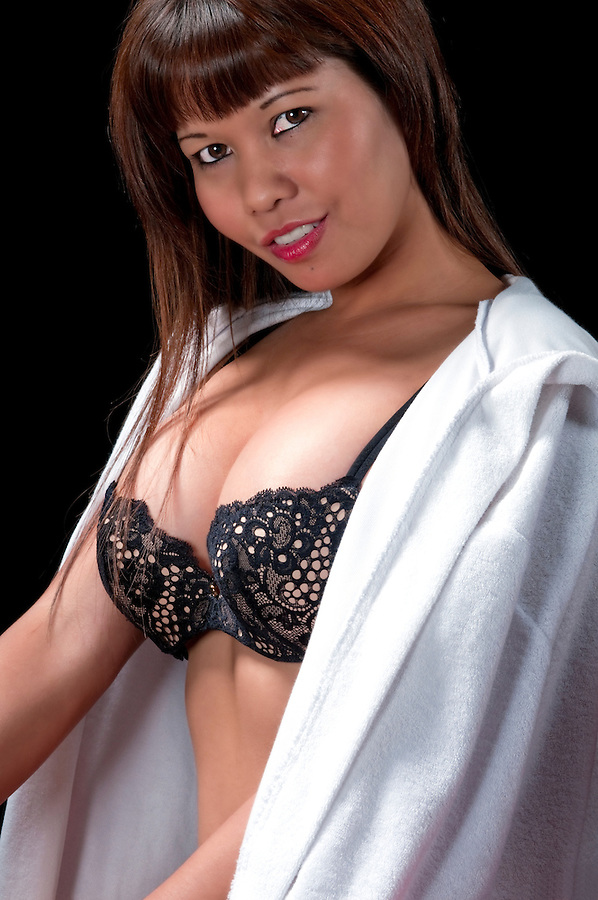 Portrait of young asian girl with lingerie and robe.