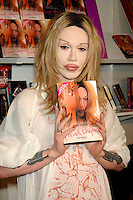 PETE BURNS<br /> (DEAD OR  ALIVE singer)<br /> Promoting his new book &quot;Freak Unique - My Story&quot; at the London Book Fair, Excell Centre, London, England, <br /> March 5th 2006.<br /> half length plastic surgery lips wig tattoo tattooes<br /> www.capitalpictures.com<br /> sales@capitalpictures.com<br /> &copy;Phil Loftus/Capital Pictures /MediaPunch ***NORTH AND SOUTH AMERICAS ONLY*** /MediaPunch ***NORTH AND SOUTH AMERICAS ONLY***