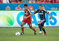 12 September 2012: Chicago Fire forward Chris Rolfe #18 and Toronto FC forward Andrew Wiedeman #32 in action during an MLS game between the Chicago Fire and Toronto FC at BMO Field in Toronto, Ontario..The Chicago Fire won 2-1..
