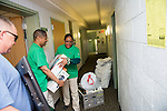 President and First Lady McDavis help a student move into their room in Johnson Hall. Photo by Ben Siegel