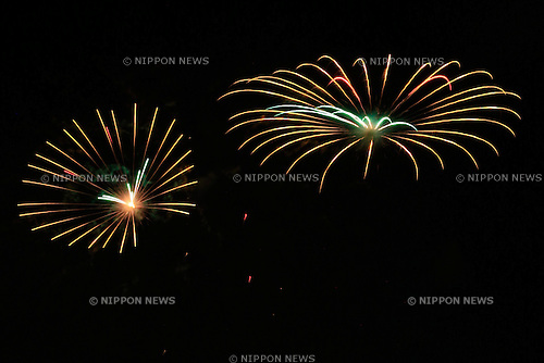 July 19, 2014, Tokyo, Japan - Adachi's annual fireworks festival displays about 12 thousand bottle rockets along the Arakawa river on July 19, 2014. The fireworks season in Tokyo is opened by this festival. (Photo by Rodrigo Reyes Marin/AFLO)