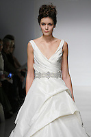 Model walks runway in a Yulia wedding dresses by Amsale Aberra, for the Kenneth Pool Spring 2012 Bridal runway show.
