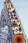 Kimono-clad 20-year-old Japanese women enjoy a ride on a roller-coaster during an event to mark Coming-of-Age Day at an amusement park in Tokyo, Japan on Monday Jan. 11, 2009. Japanese enter adulthood at 20, when they can legally smoke, drink alcohol and vote, though debate is heating up as to whether or not the age should be lowered to 18 in line with many advanced countries. Indeed, the Japanese government plans to lower the voting age to 18 as of mid-2010.   .Photographer: Robert GilhoolyCOMING OF AGE