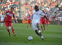 Toronto defender Andy Iro (3) clears the ball in front of Chicago midfielder Logan Pause (12).  The Chicago Fire defeated Toronto FC 2-0 at Toyota Park in Bridgeview, IL on August 21, 2011.