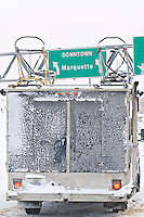 A mushers truck with a sign for downtown Marquette Michigan during the UP 200 Sled Dog Championship mushing race.