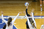 11 September 2015: Stanford's Merete Lutz (17) hits towards Duke's Emily Sklar (9) and Leah Meyer (7). The Duke University Devils hosted the Stanford University Cardinal at Cameron Indoor Stadium in Durham, NC in a 2015 NCAA Division I Women's Volleyball contest. Stanford won the match 3-2 (17-25, 25-22, 17-25, 25-23, 10-15).