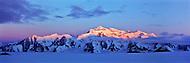 Alpenglow creeps down the face of Mount Logan, Kluane National Park