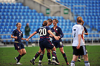 Carli Lloyd is congratulated by Abby Wambach (#20), and Heather Mitts (#2) after scoring a goal.  The USA captured the 2010 Algarve Cup title by defeating Germany 3-2, at Estadio Algarve on March 3, 2010.