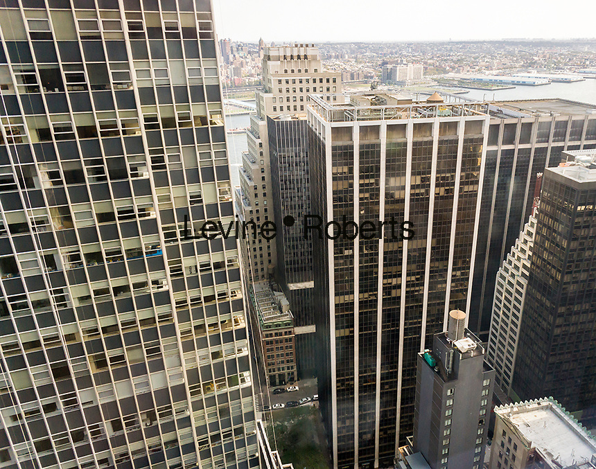 Office buildings in Lower Manhattan in New York on Sunday, October 16, 2016. Looking East, Brooklyn is in the background. (© Richard B. Levine)