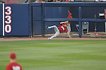 Alabama left fielder Andrew Miller makes a catch on a ball hit by Ole Miss' Matt Snyder (33) at Oxford-University Stadium in Oxford, Miss. on Friday, March 18, 2011. Ole Miss won 4-0. The Rebels are 15-4 on the season and 1-0 in SEC play.  (AP Photo/Oxford Eagle, Bruce Newman)