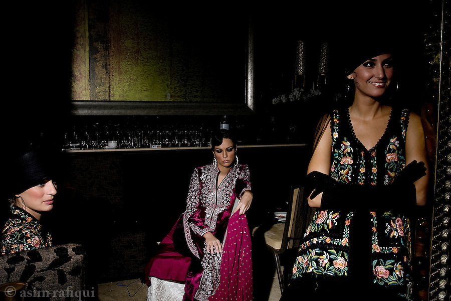 Models wait backstage at a Rizwan Beyg fashion show before stepping onto the catwalk.  Rizwan Beyg typifes a new generation that straddles both the east and the west.  Rizwan's designs are rooted in Pakistani/Indian embroidary traditions, while his cuts are distinctly aimed at the modern woman.
