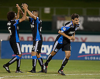 Justin Morrow (left) celebrates with Jason Hernandez (center) while Mike Wondolowski runs to celebrate with goalkeeper Jon Busch. The San Jose Earthquakes defeated Chivas USA 6-5 in shootout after drawing 0-0 in regulation time to win the inagural Sacramento Cup at Raley Field in Sacramento, California on June 12, 2010.
