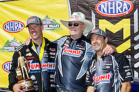 Jun 19, 2016; Bristol, TN, USA; NHRA pro stock driver Jason Line (left) celebrates with team owner Ken Black (center) and teammate Greg Anderson after winning the Thunder Valley Nationals at Bristol Dragway. Mandatory Credit: Mark J. Rebilas-USA TODAY Sports