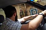 Hebron. IDF guards are seen at a checkpoint through a car window.