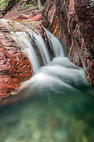 Little waterfall, red rocks, green pool.  I love the juxtaposition opportunities provided with a short wade up Red Creek in Waterton Lakes National Park of Alberta Canada